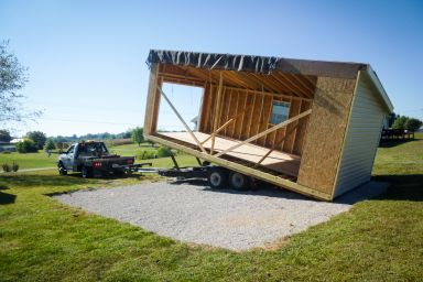 Delivery of a modular prebuilt garage in Kentucky with vinyl siding