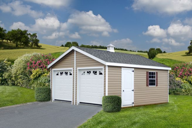 A custom prebuilt garage in Kentucky with vinyl siding and windows