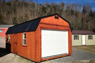 A prebuilt garage in Tennessee with wooden siding and a loft