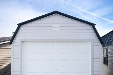 A prebuilt garage in Tennessee with white vinyl siding and a loft
