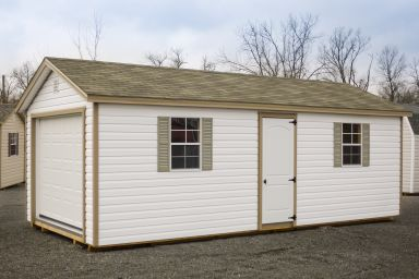 A garage shed in Kentucky with vinyl siding and two windows