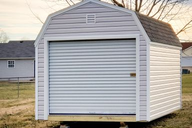 A prefab garage in Kentucky with vinyl siding and a roll-up door