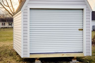 A prefab garage in Kentucky with a roll-up door and a loft