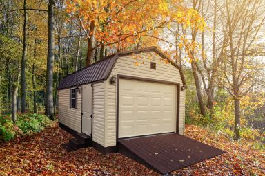 A custom prefab garage in Kentucky with vinyl siding and a metal roof