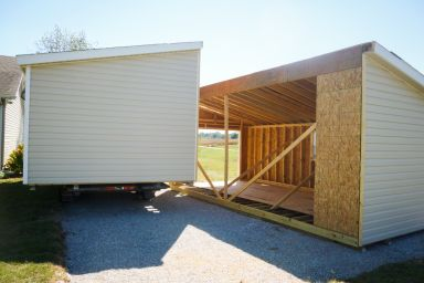A vinyl modular garage in Kentucky being assembled