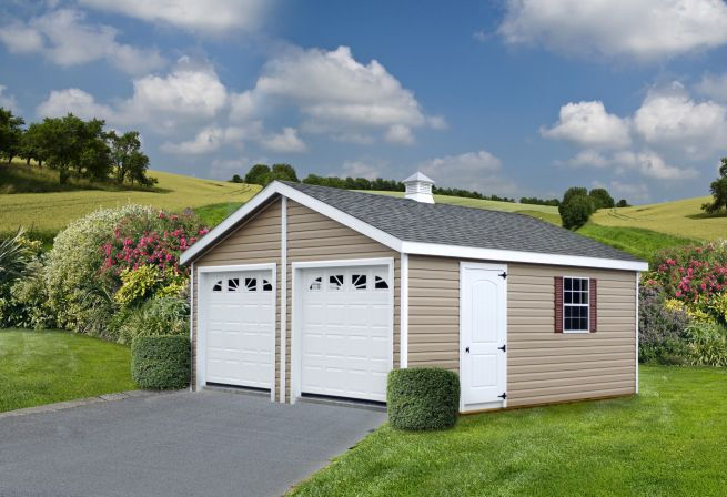 A prefab two-car garage in Tennessee with vinyl siding and a cupola